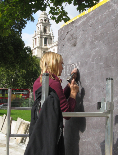 Image Pippa carving the David Lloyd George plinth in Parliament Square