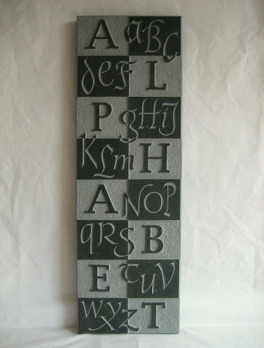 Image of alphabet carved on Green Slate